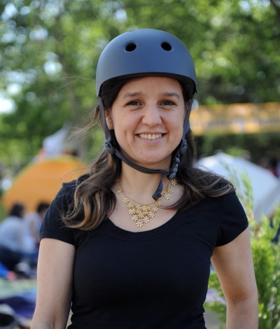 Zeynep Tufekci smiling and wearing a helmet during the 2013 Istanbul protests